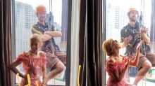 Kylie Minogue upstaged by window cleaner's photobomb in Sydney