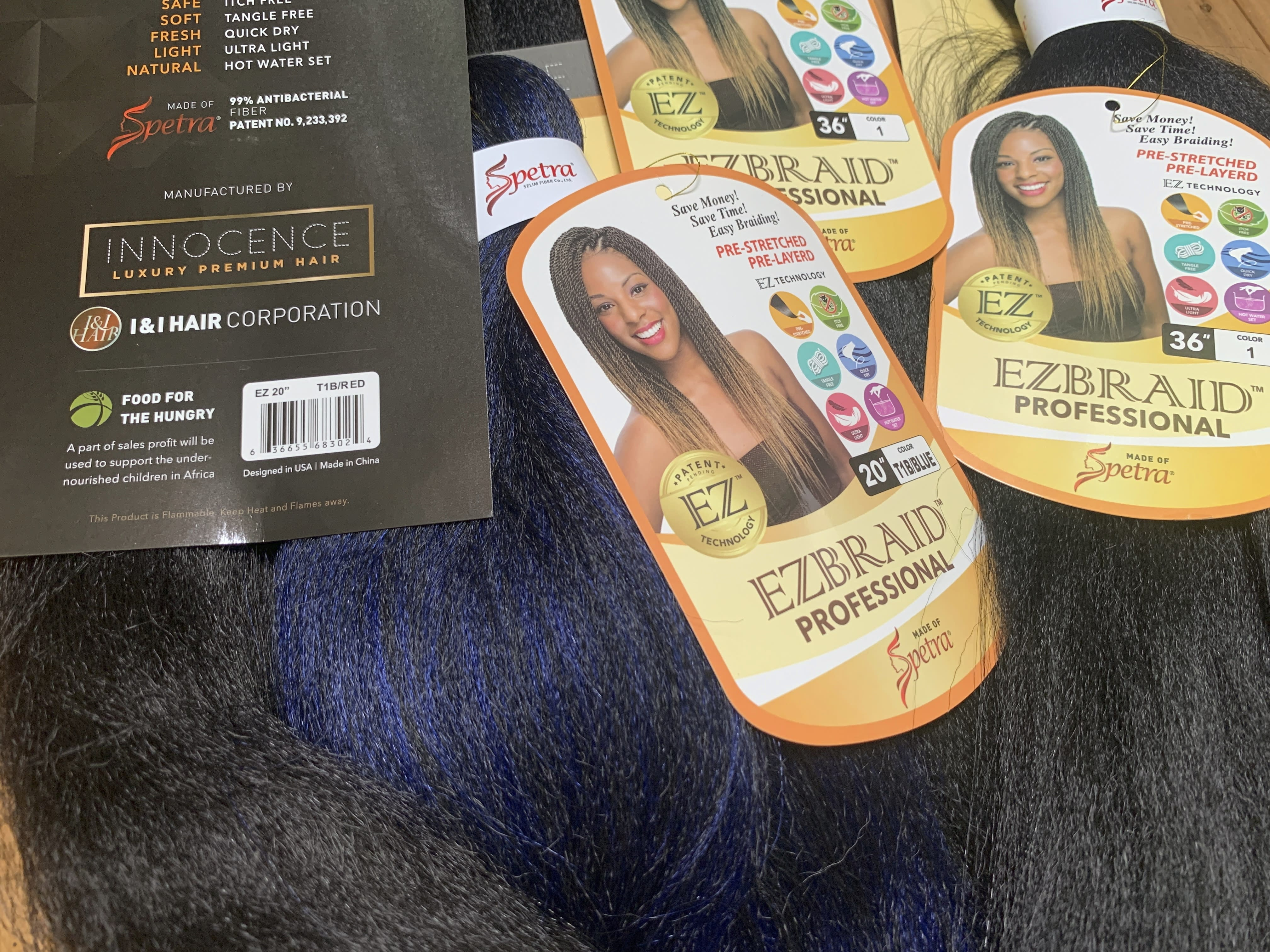 Samples of Pre-stretched Innocence EZBRAND Professional Antibacterial Braid hair extensions from I&I Hair Corporation, purchased in May, are seen in this photo in New York on Wednesday, July 1, 2020. Federal authorities in New York on Wednesday seized a shipment of weaves and other beauty accessories from I&I and other importers suspected to be made out of human hair taken from people locked inside a Chinese internment camp. (AP Photo/Wong Maye-E)