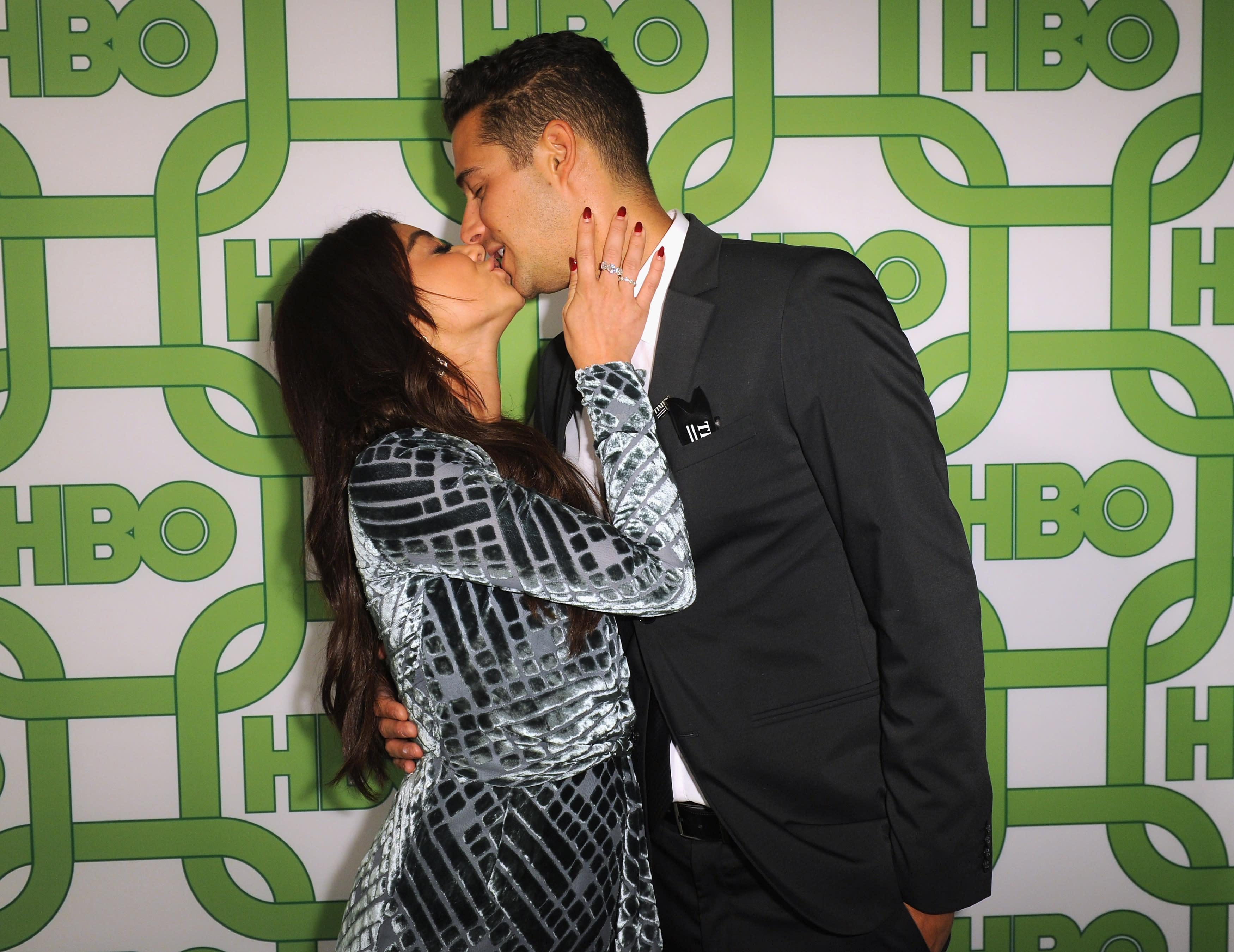 Sarah Hyland and fiancé Wells Adams wear Mr. and Mrs. face masks after postponing wedding