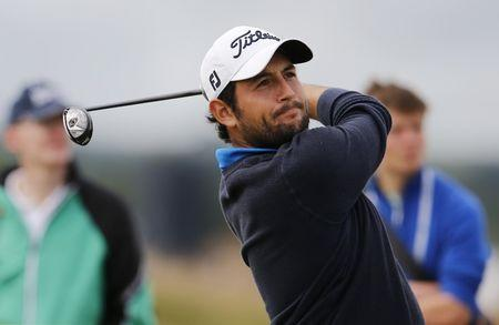 Levy of France watches his tee shot on the tenth hole during the first round of the British Open golf championship on the Old Course in St. Andrews, Scotland
