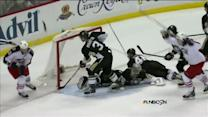 Jenner chips the puck by Fleury in front