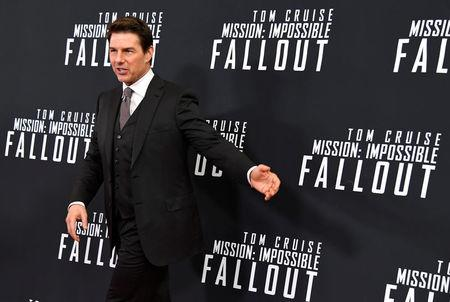 Actor Tom Cruise gestures as he arrives on the red carpet for the premiere of Mission:Impossible-Fallout, at the Smithsonian's National Air and Space Museum, in Washington, U.S., July 22, 2018. REUTERS/Mike Theiler
