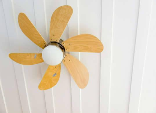 """<p>We all know that warm air rises, but this common fact can have a chilling effect on our heating bills. Although it seems like switching your <a href=""""http://www.bobvila.com/slideshow/blades-of-glory-10-ceiling-fans-with-sharp-style-44382"""" rel=""""nofollow noopener"""" target=""""_blank"""" data-ylk=""""slk:ceiling fan"""" class=""""link rapid-noclick-resp"""">ceiling fan</a> on would cool things off, doing so can actually make your spaces toastier, so long as you set the blades to spin in a clockwise manner. (To reverse the rotation, check for a switch at the base of your fan.) This change of direction creates a slight updraft that will push the warm air toward the walls and back down into the room. <i>Photo: fotosearch.com</i><br>RELATED: <a href=""""http://www.bobvila.com/slideshow/slash-your-electric-bill-with-11-savvy-hacks-48497"""" rel=""""nofollow noopener"""" target=""""_blank"""" data-ylk=""""slk:Slash Your Electric Bill with 11 Savvy Hacks"""" class=""""link rapid-noclick-resp"""">Slash Your Electric Bill with 11 Savvy Hacks</a></p>"""