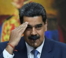Ex-Venezuela general charged with drug trafficking surrenders to US