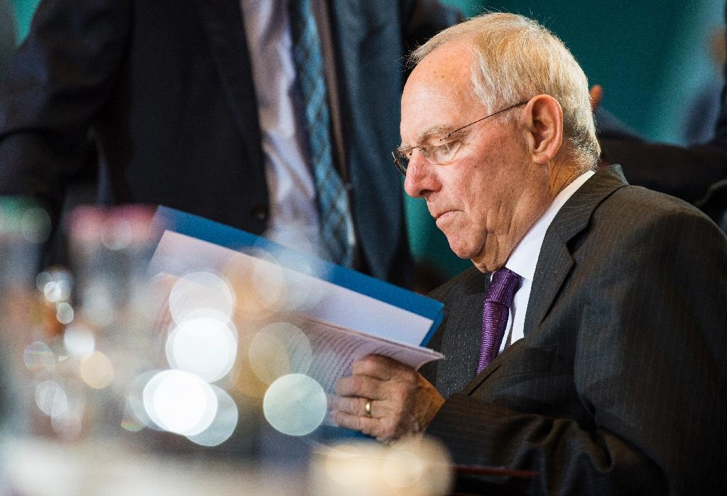 """German Finance Minister Wolfgang Schaeuble said the ECB should begin winding down its expansive monetary policy in 2017, but acknowledged it would be a """"difficult task"""""""