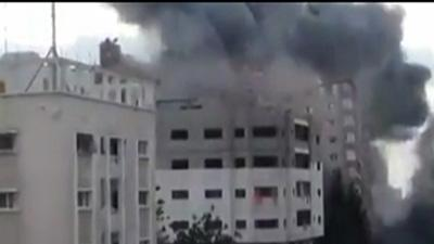 Raw: Building Collapses After Gaza Airstrike