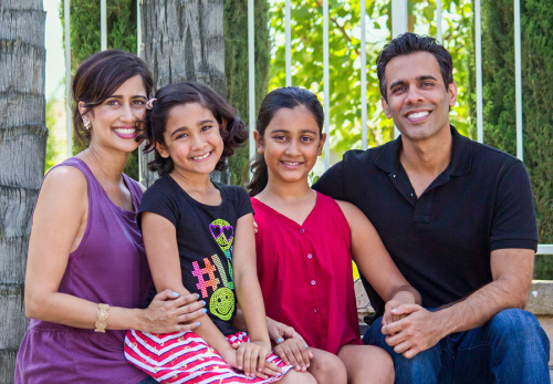 Nicole Brar, second from left, and her family claim her private school would not respect her gender identity.