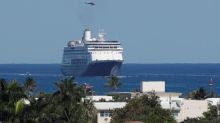Passengers on COVID-19-stricken cruise ships hope to be on land again soon