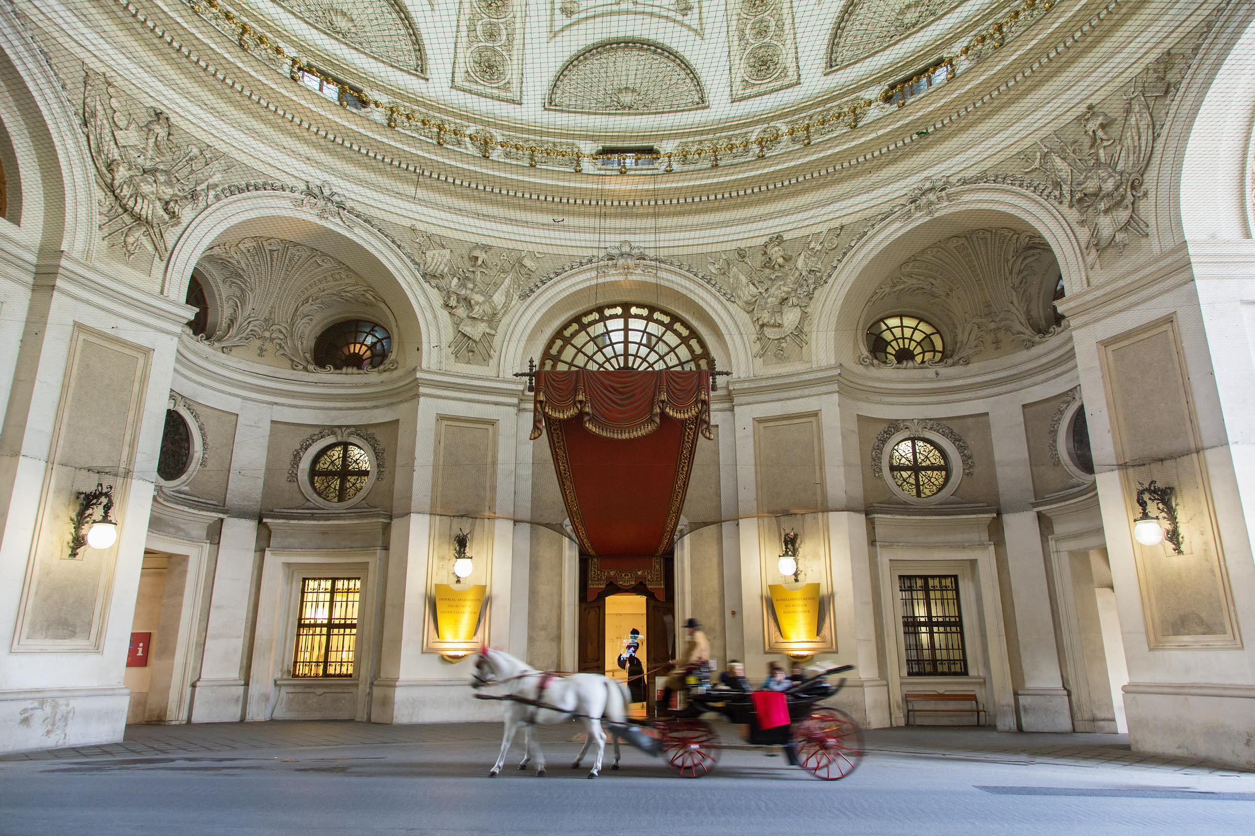 """<p><span style=""""font-family:helvetica, arial;font-size:16px;background-color:rgb(255, 255, 255);"""">Vienna is like a romantic city that you might read about in fairytales. Horse-drawn carriages are ready to collect you on Stephansplatz, Albertinaplatz and in front of the Hofburg, to take you for an evening spin around the stunning city. You'll be surrounded by the romantic classical music of Mozart, and will be in awe of the romantic splendour surrounding you. From delightful cobbled streets to opulent coffee shops, fully furnished with chandeliers, everything about Vienna breathes class. Marvel at the regal splendour of Vienna's palaces, spend an evening at the opera or ballet, the 'Staatsoper' (Vienna state opera), gazing down at the world-famous Vienna Philharmonic in the pit below.</span></p>"""
