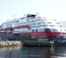 Norway suspends cruise ship arrivals with 100+ people on board after virus outbreak