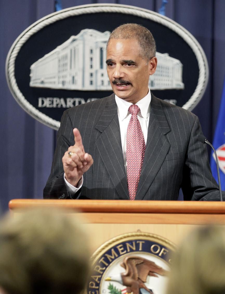 This Oct. 4, 2010 file photo shows Attorney General Eric Holder speaking during a news conference at the Justice Department in Washington. Holder is calling for major changes to the nation's criminal justice system that would scale back the use of harsh prison sentences for certain drug-related crimes, divert people convicted of low-level offenses to drug treatment and community service programs and expand a prison program to allow for release of some elderly, non-violent offenders. (AP Photo/Carolyn Kaster, File)