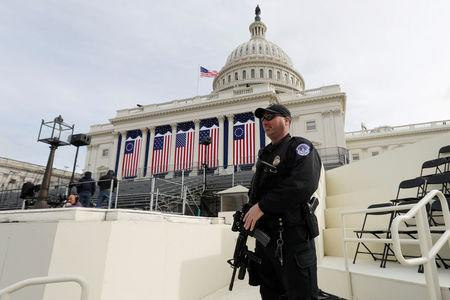 A Capitol Police officer stands guard at the U.S. Capitol before the inauguration of U.S. President Elect Donald Trump in Washington, DC, U.S., January 19, 2017. REUTERS/Brian Snyder