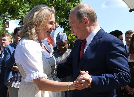 Austria's Foreign Minister Karin Kneissl dances with Russia's President Vladimir Putin at her wedding in Gamlitz, Austria, August 18, 2018. Roland Schlager/Pool via Reuters