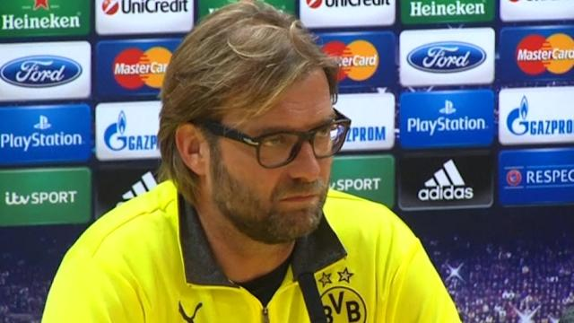 Dortmund coach expects two close games with Arsenal in Champions League