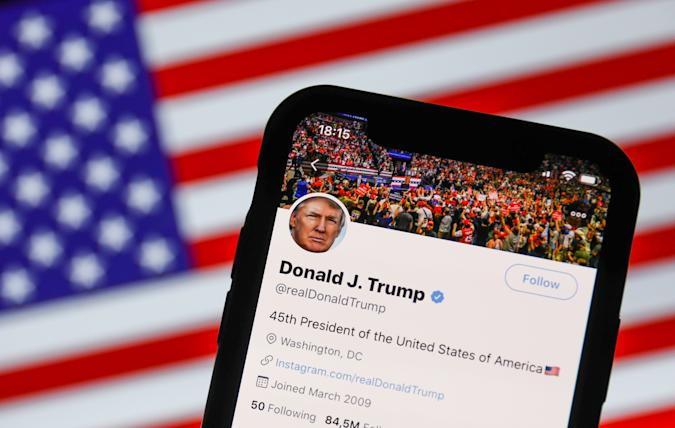 Twitter feed of the President of the USA Donald Trump is seen displayed on a phone screen with American flag in the background in this illustration photo taken on August 2, 2020. President of the USA Donald Trump said that Chinese app TikTok will be banned in the United States. (Photo Illustration by Jakub Porzycki/NurPhoto via Getty Images)