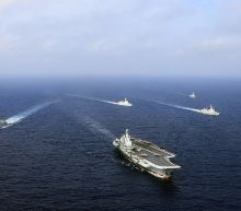 Chinese carrier leads live fire drill in East China Sea