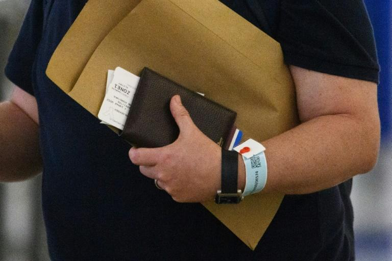 Governments are using various kinds of tracking such as these electronic bracelets in Hong Kong connected to an app to monitor people and curb the spread of COVID-19 (AFP Photo/ANTHONY WALLACE)