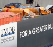 Malaysia police investigating spouse of ex-central bank boss over 1MDB funds