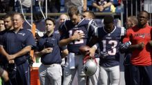 Trump's buddy Tom Brady links arm with teammate during national anthem