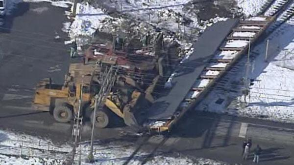 Derailed train car blocks road in South Coatesville