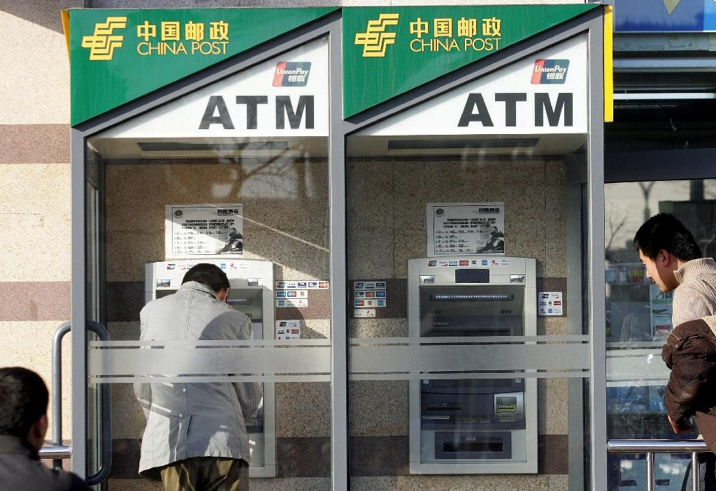 beijing tries to overhaul china s banks thru ipos