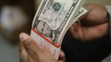 Dólar cai mais de 1% ante real com Fed, mas tem maior valorização semanal desde maio com cena política