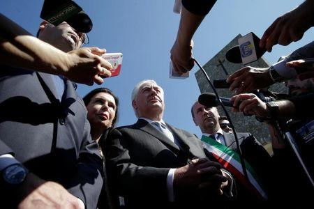 U.S. Secretary of State Rex Tillerson, talks to reporters during a ceremony at the Sant'Anna di Stazzema memorial