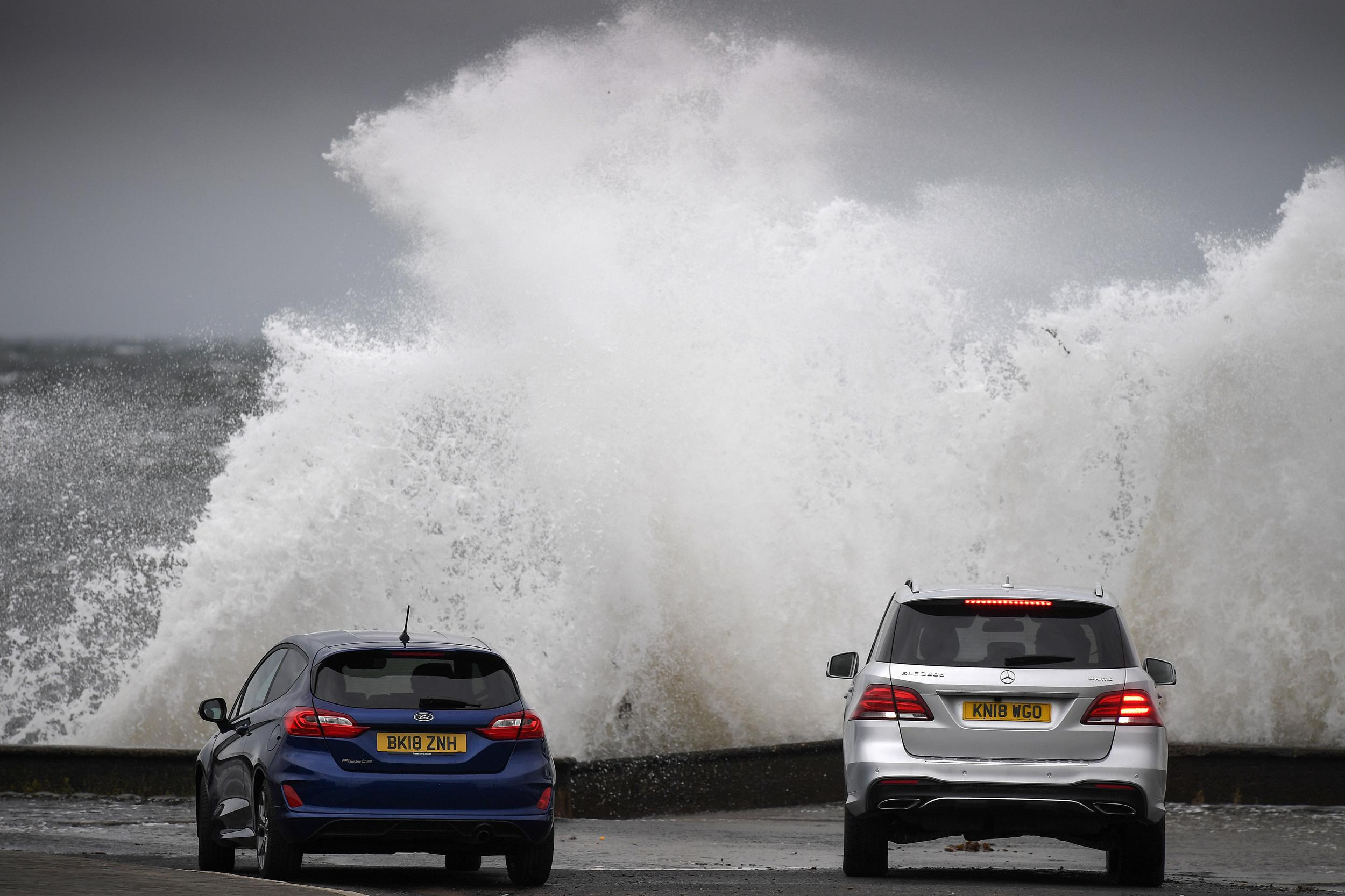 PRESTWICK, SCOTLAND - FEBRUARY 08: Members of the public look on as Storm Erik makes landfall with winds of up to 70mph due to hit some areas of the UK along with heavy rain on February 8, 2019 in Prestwick, Scotland. The Met Office issued two yellow be aware warnings for Friday for strong winds across western Scotland until the evening, and for heavy rain until Saturday afternoon. (Photo by Jeff J Mitchell/Getty Images)