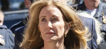 Embattled Felicity Huffman wants her passport back