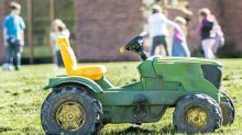 Police rescue 2-year-old who drove battery-powered toy tractor to county fair
