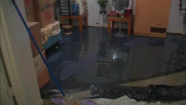 Raw sewage backing up and flooding basements in Queens