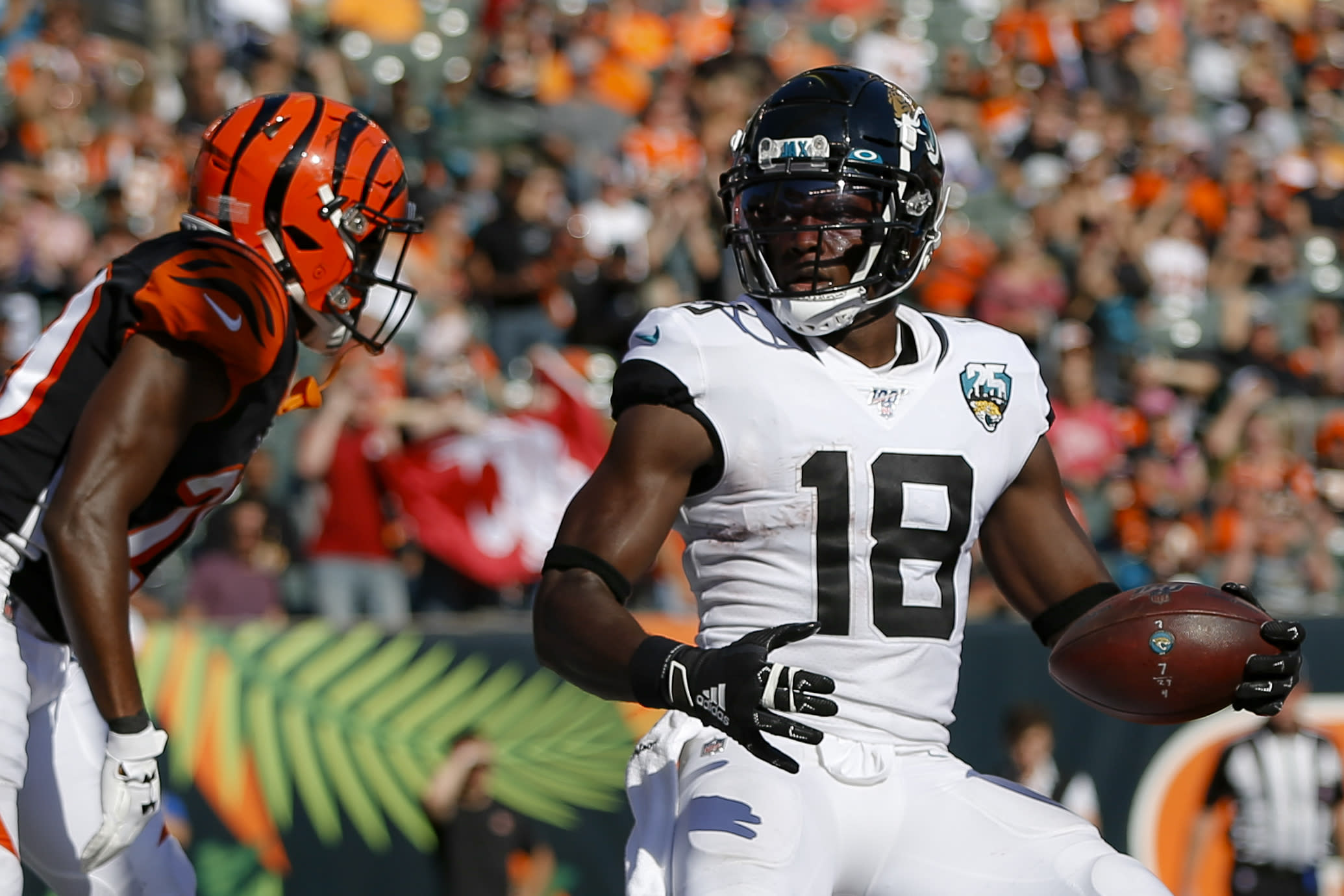 """FILE - In this Oct. 20, 2019, file file photo, Jacksonville Jaguars wide receiver Chris Conley (18) scores a 2-point conversation in the second half of the team's NFL football game against the Cincinnati Bengals in Cincinnati. Conley called on """"figures who are the face of the league"""" to do more to help fight social injustice. The sixth-year pro made it clear Thursday, Aug. 27, he was talking about the NFL's top quarterbacks, the ones who have the most influence in games, in locker rooms and in communities. Think Tom Brady, Drew Brees, Patrick Mahomes, Deshaun Watson, Russell Wilson and Lamar Jackson, for starters. (AP Photo/Frank Victores, File)"""
