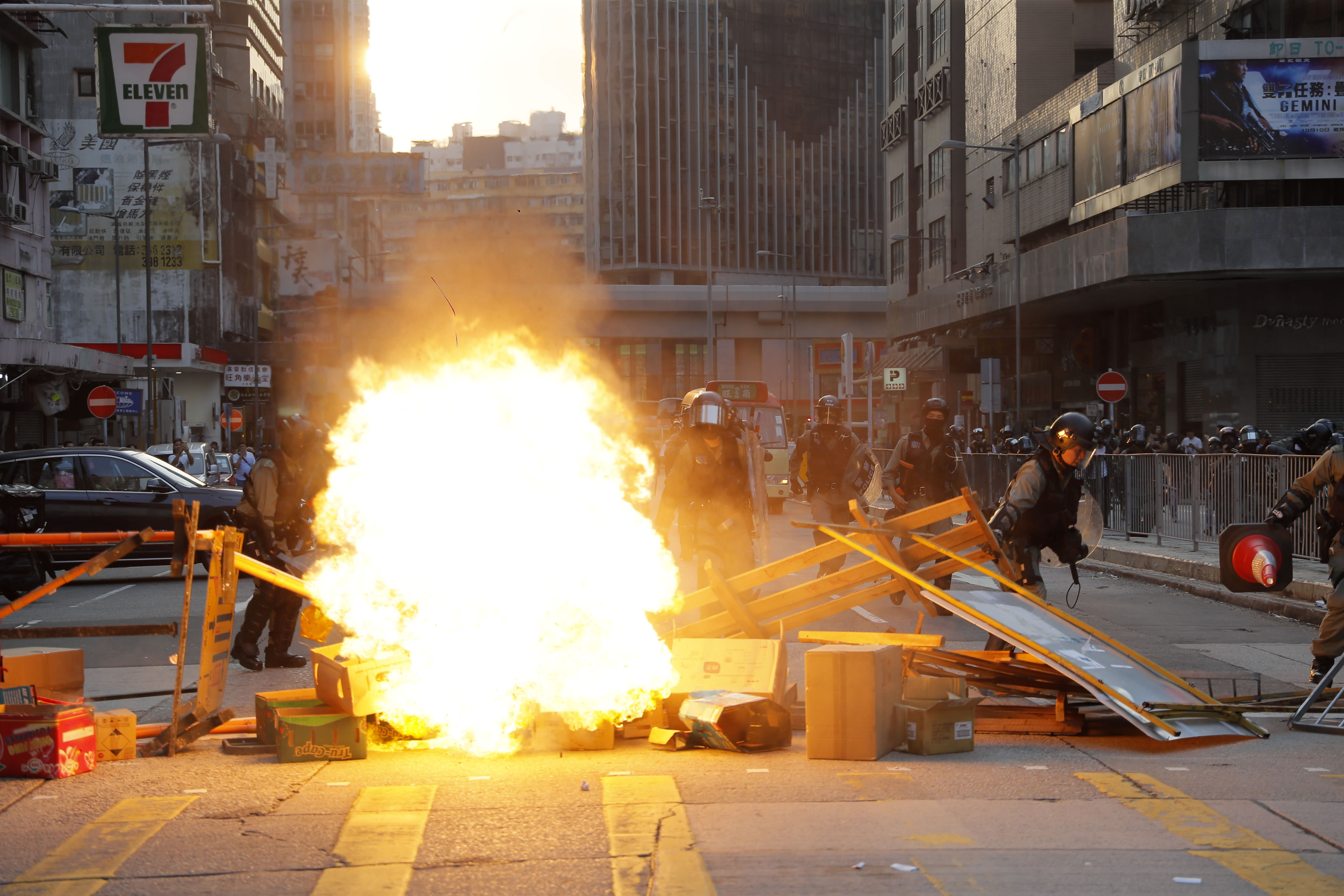 Protestors make fire to block traffic in Hong Kong, Sunday, Oct. 20, 2019. Hong Kong protesters again flooded streets on Sunday, ignoring a police ban on the rally and setting up barricades amid tear gas and firebombs. (AP Photo/Kin Cheung)