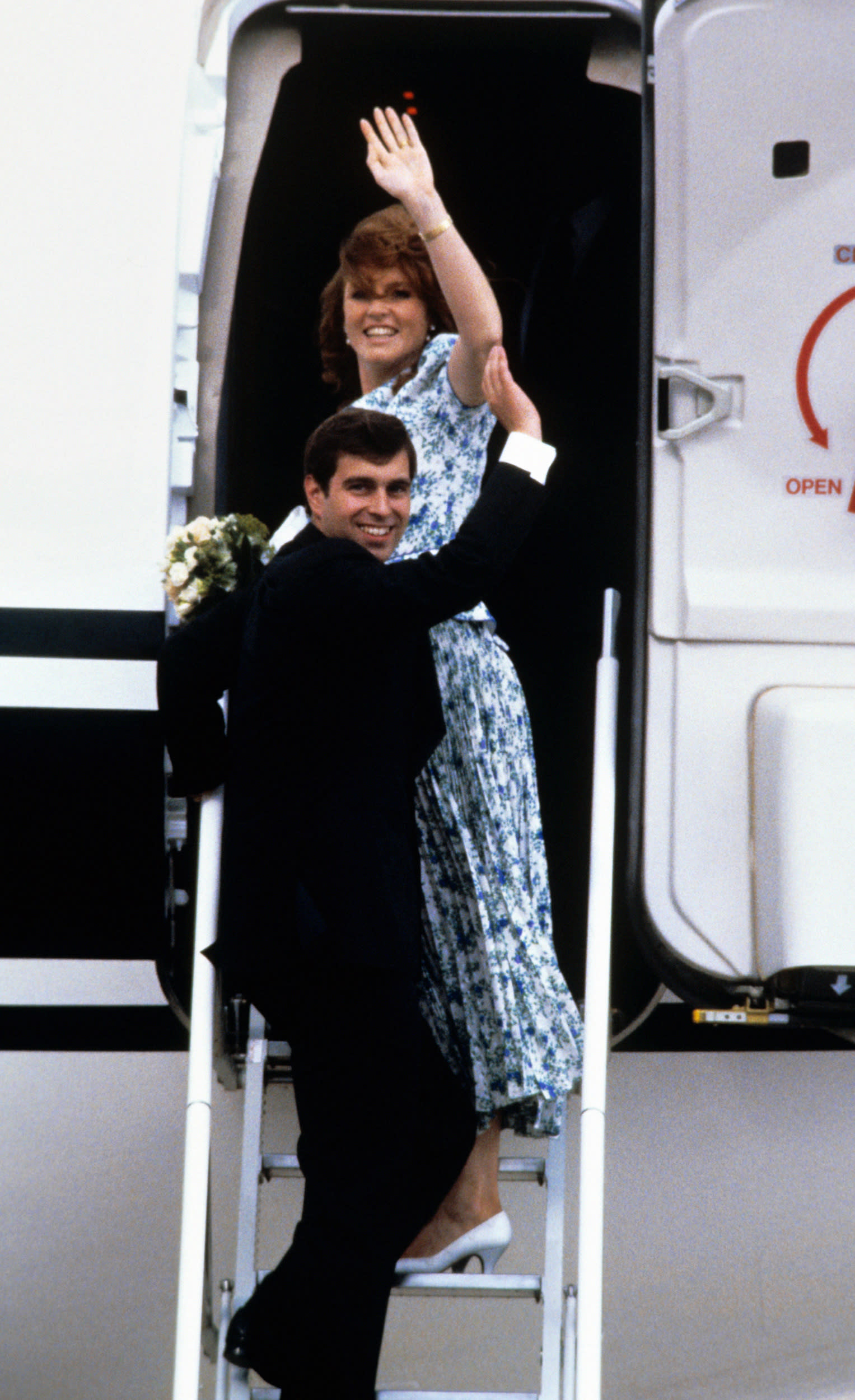 The newly-wed Duke and Duchess of York wave as they board the jet at Heathrow Airport, London, carrying them to the Azores for their honeymoon.