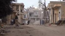 Gunfire in Syrian town, as civil war moves into fourth year