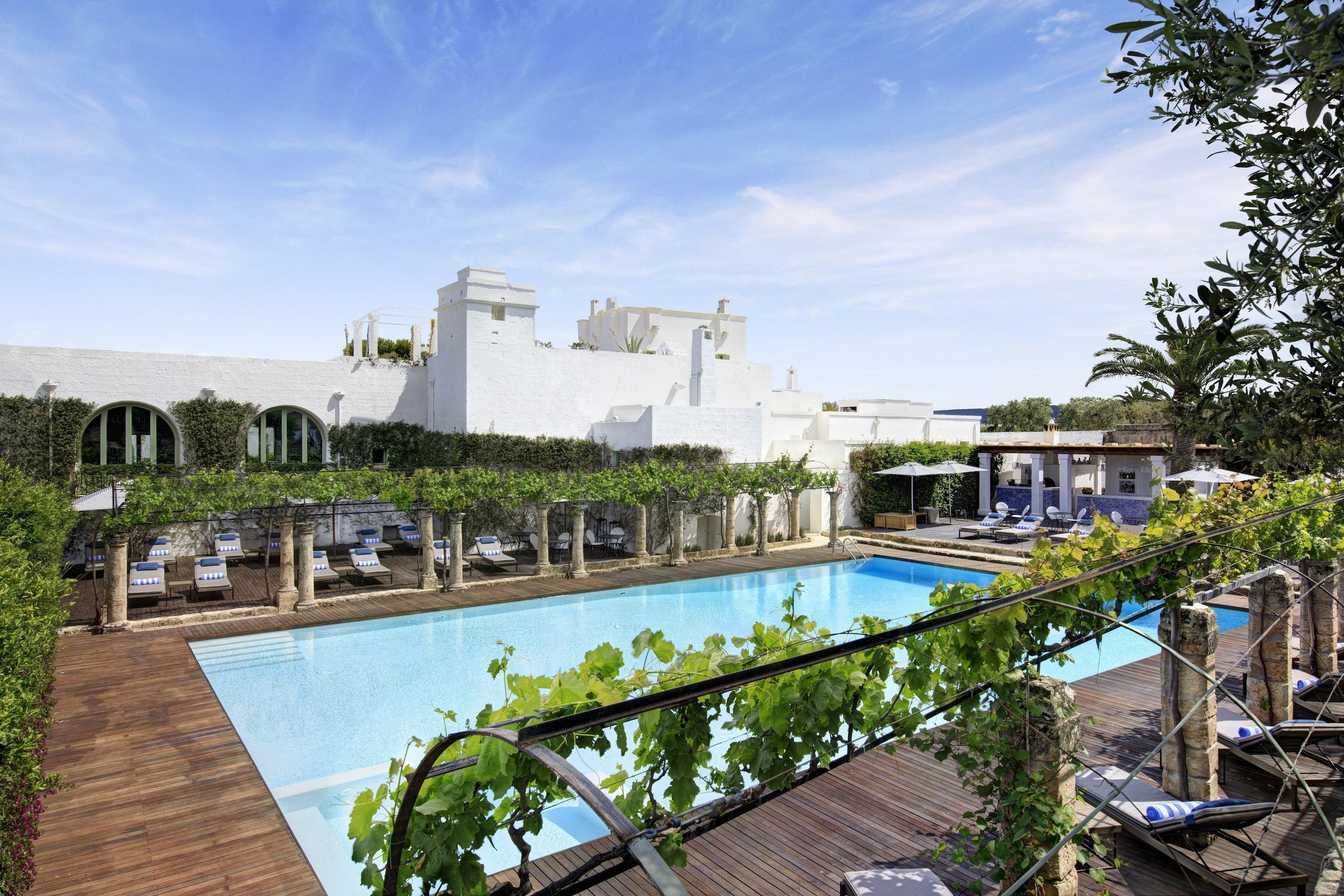 """<a href=""""https://www.roccofortehotels.com/hotels-and-resorts/masseria-torre-maizza/"""" rel=""""nofollow noopener"""" target=""""_blank"""" data-ylk=""""slk:A former farmhouse"""" class=""""link rapid-noclick-resp""""><em>A former farmhouse</em></a><em>:</em> English-Italian hotelier Rocco Forte is the most recent to take a stake in wave of <em>masserie</em> turned swanky hotels in Puglia. The perfect blend of old and new, the former 16th-century farmhouse turned Masseria Torre Maizza now comes complete with a rooftop terrace, loads of bougainvillea-covered white walls, a day spa, and 40 decadently appointed rooms and suites by Olga Polizzi."""