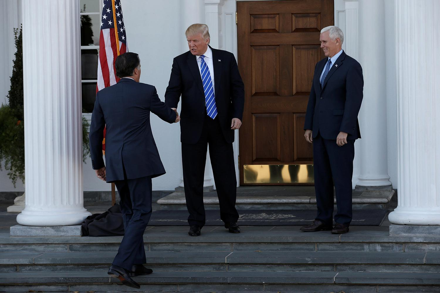 <p>U.S. President-elect Donald Trump and Vice President-elect Mike Pence greet former Massachusetts Governor Mitt Romney (L) as he arrives for their meeting at the the main clubhouse at Trump National Golf Club in Bedminster, New Jersey, Nov. 19, 2016. (Photo: Mike Segar/Reuters) </p>