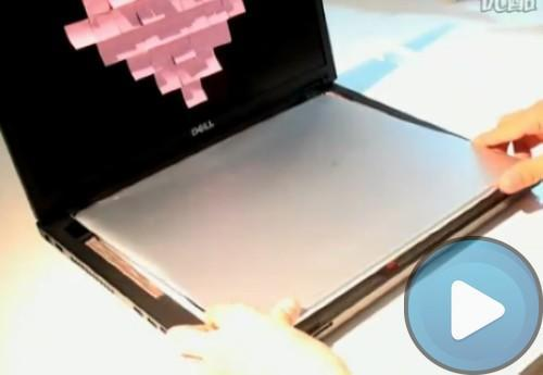 Dell Adamo gets jammed inside another Dell laptop: yes, it's that thin!