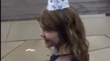 Little girl's friends sing 'Happy Birthday' to her from their cars while practicing social distancing