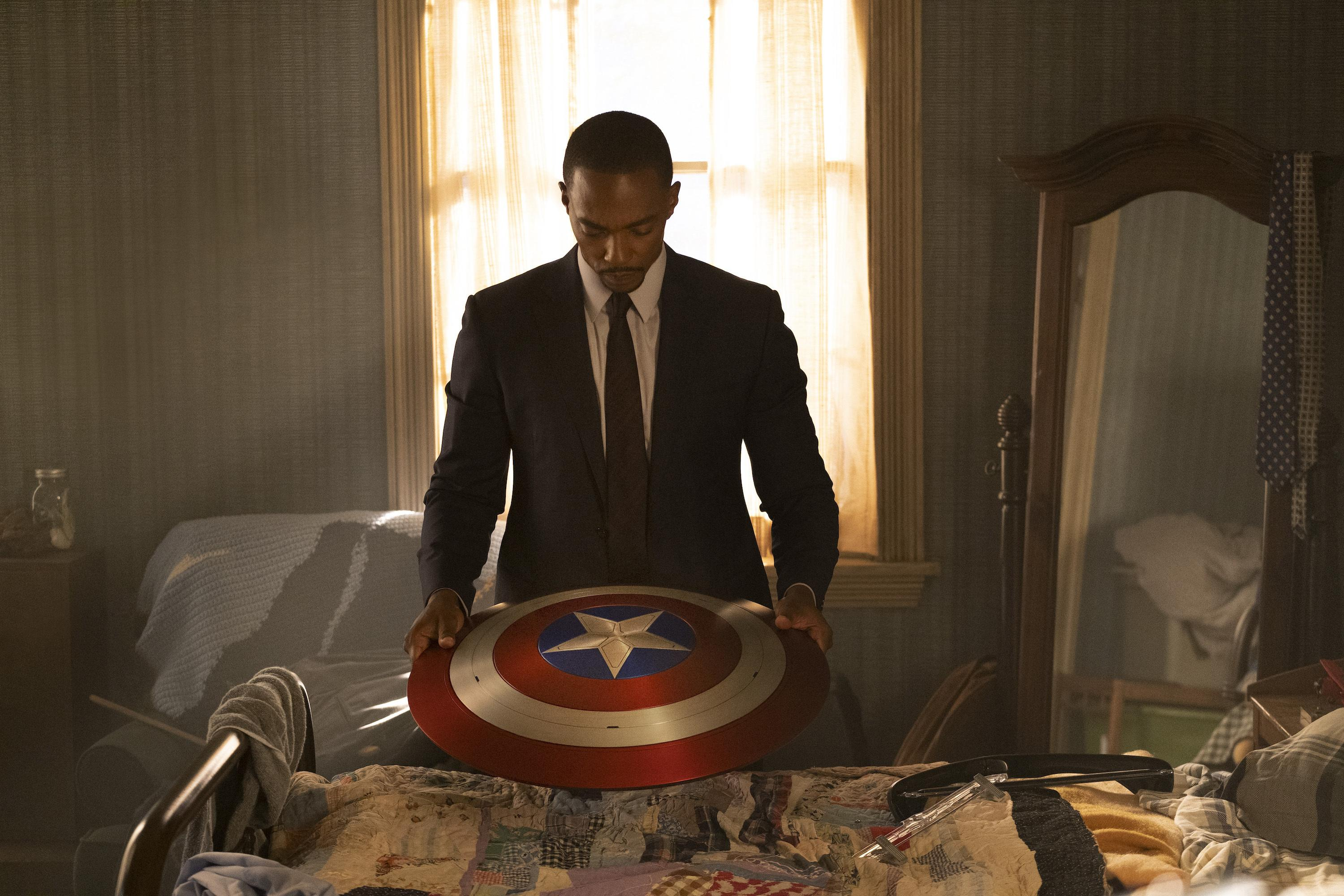 Anthony Mackie as Sam Wilson/Falcon holding Captain America's shield in 'The Falcon and the Winter Soldier.'