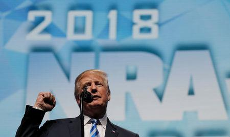 President Donald Trump makes a fist as he addresses the National Rifle Association (NRA) Convention in Dallas, Texas, May 4, 2018. REUTERS/Carlos Barria