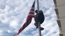 Navy SEAL climbs flagpole to fix American flag in viral video