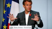 France's Macron backs 5G technology over 'going back to the oil lamp'