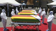 Zimbabwe holds burial for 3 top leaders who died of COVID-19