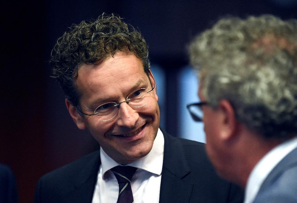 """Dutch Finance Minister and President of Eurogroup Jeroen Dijsselbloem (L) said Eurozone finance ministers had achieved a """"major breakthrough"""" on a debt relief deal with Greece (AFP Photo/John Thys)"""