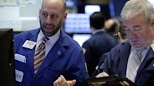 Dow spikes 322 points, closes above 26,000 for the first time