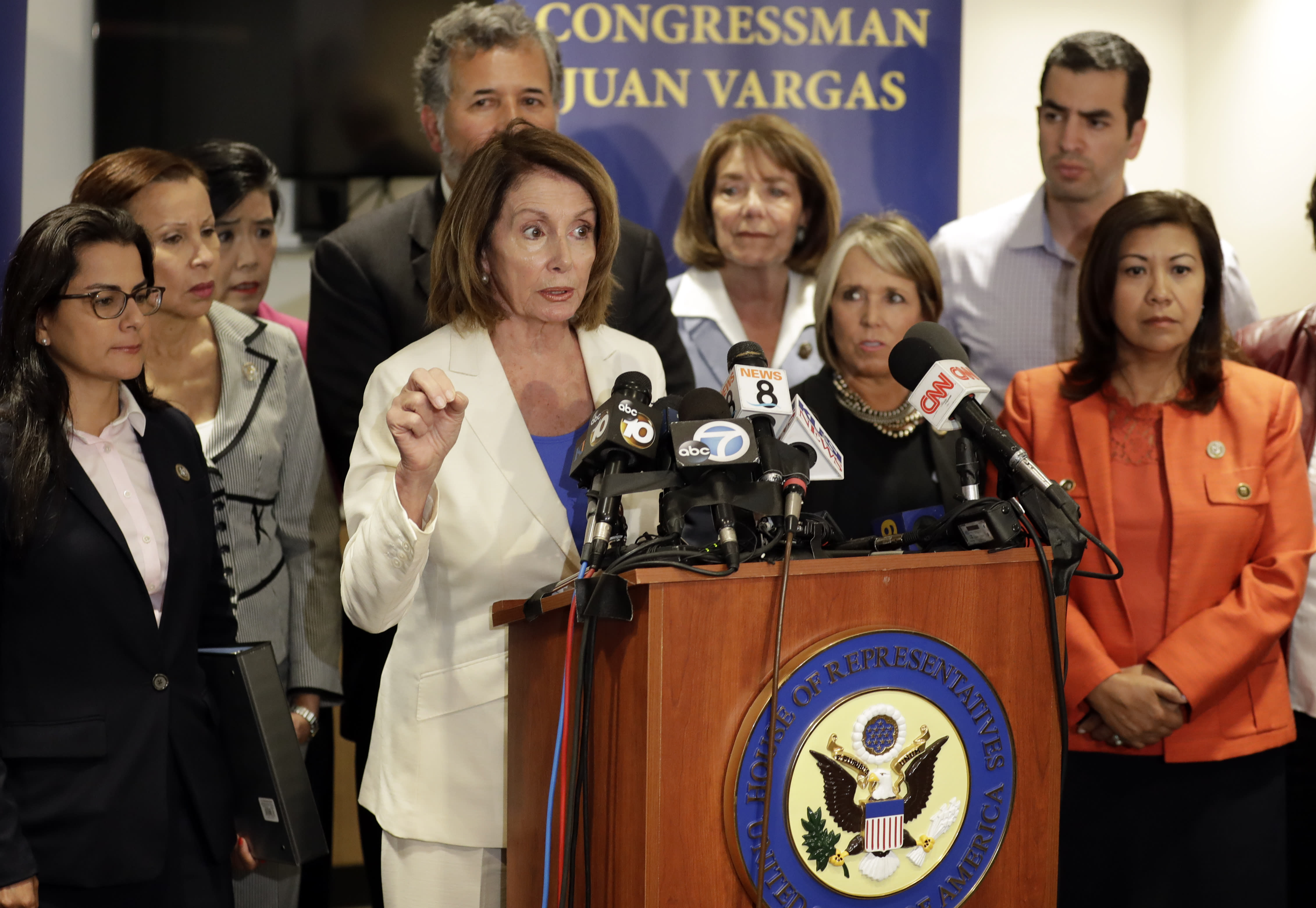 """<span class=""""s1"""">House Minority Leader Nancy Pelosi, D-Calif., surrounded by members of the Congressional Hispanic Caucus, talks about their visit to a detention facility near San Diego. (Photo: Gregory Bull/AP)</span>"""