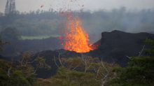 Hawaii lava flow engulfs more homes as ash plume ascends