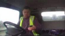 Watch: Lorry driver uses mobile phone as he smashes into line of cars