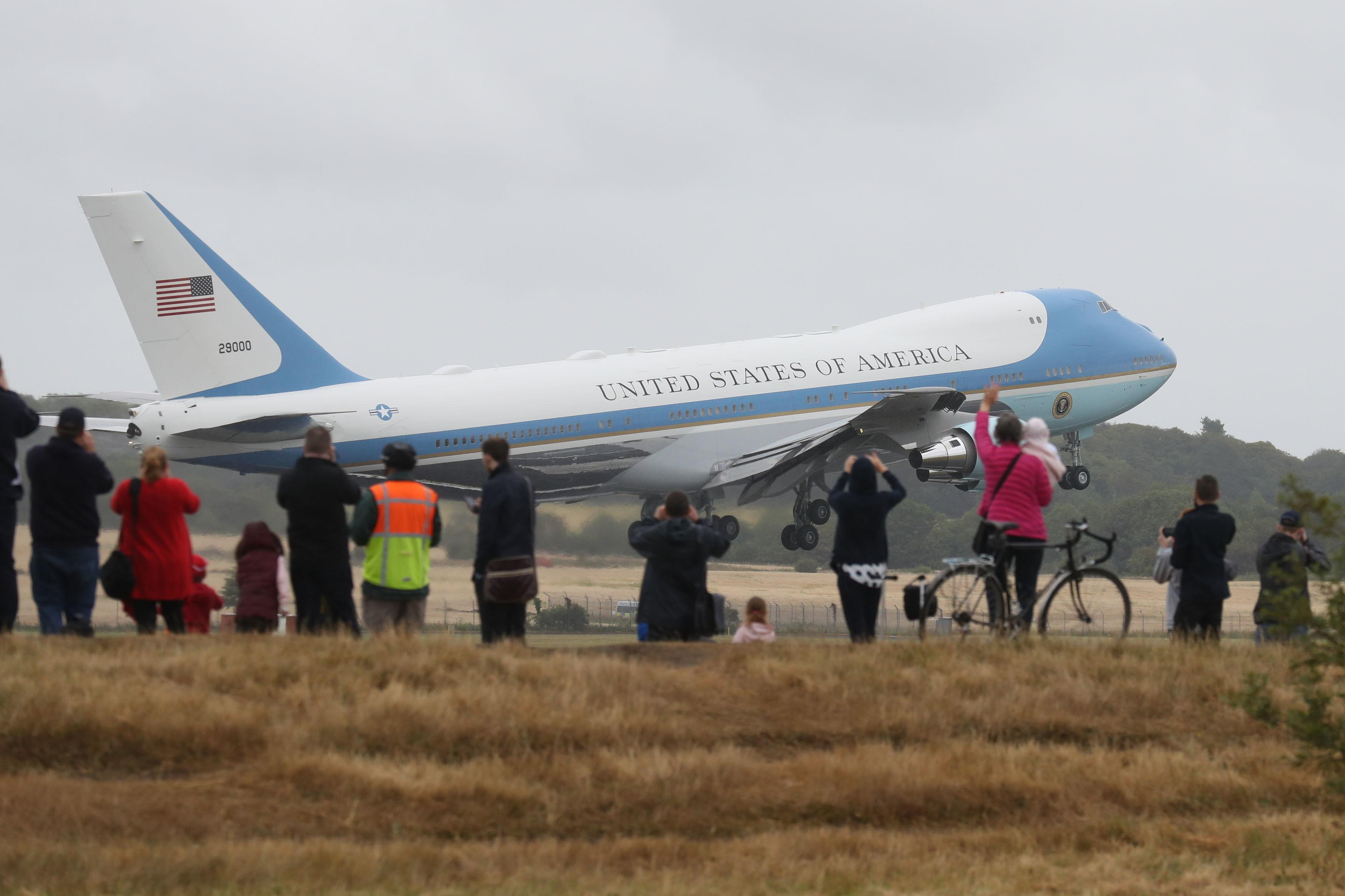 <p>People watch as Air Force One takes off from Prestwick Airport in Ayrshire, as President Donald Trump and his wife Melania leave the U.K. , after spending the weekend at the Trump Turnberry resort, bound for Finland where the president will hold talks with Russian leader Vladimir Putin in Helsinki, following meetings with Theresa May and the Queen in a whirlwind tour that took place amid mass protests against his policies across the U.K. (Photo: Andrew Milligan/PA Images via Getty Images) </p>